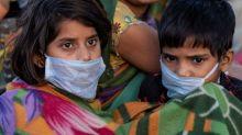 Indian police fire tear gas on jobless workers defying coronavirus lockdown