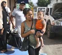 The Latest: Baby didn't initially know parents at reunion