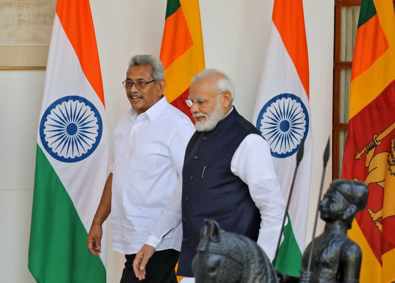 Sri Lanka's President Rajapaksa and India's PM Modi arrive for a photo opportunity ahead of their meeting at Hyderabad House in New Delhi