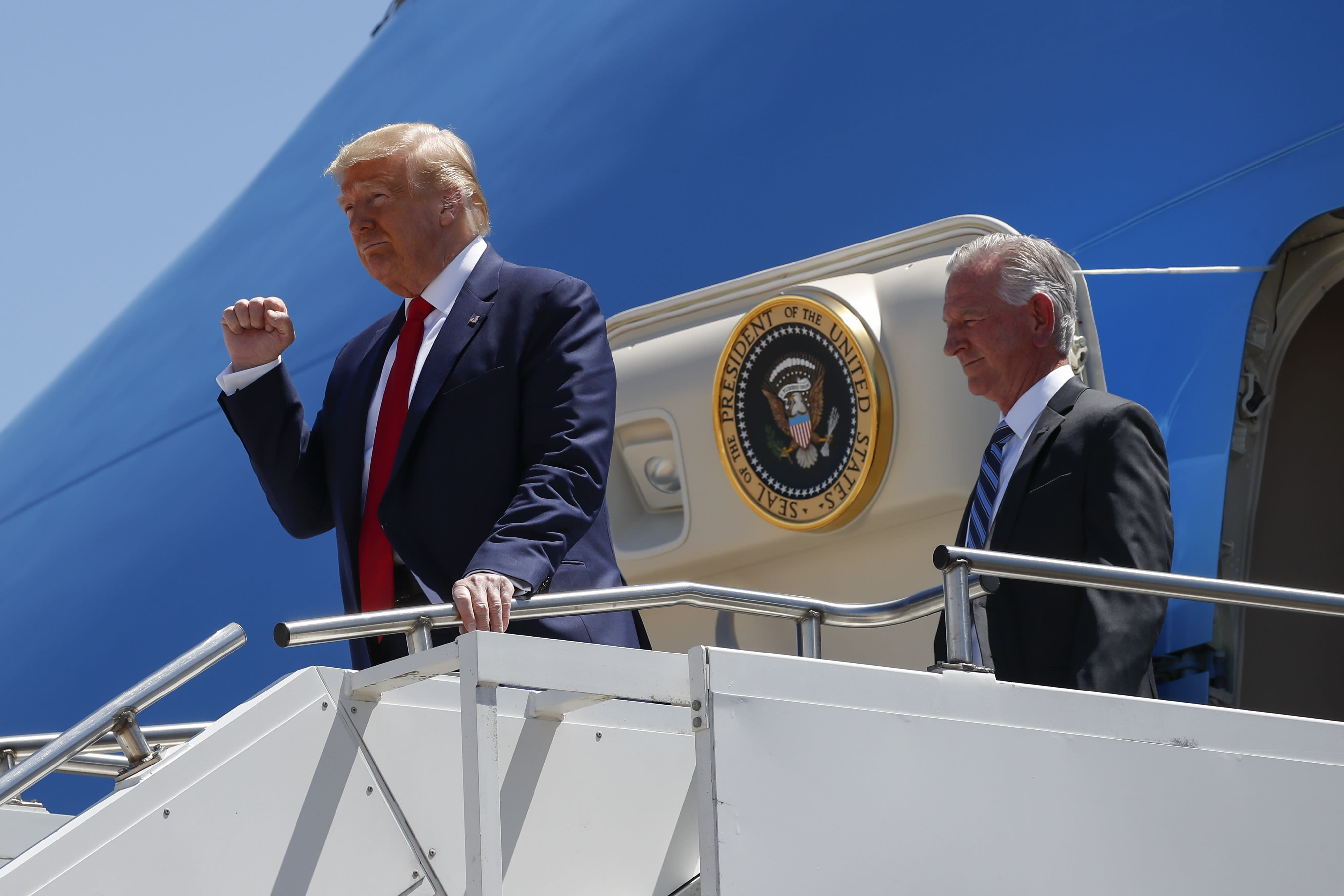 "FILE - In this June 11, 2020, file photo President Donald Trump gestures as he steps off Air Force One at Dallas Love Field in Dallas with Senate candidate Tommy Tuberville. Trump has endorsed Tuberville in the race, turning decisively against his former attorney general with direct appeals for Alabama voters to reject Sessions's candidacy. ""Do not trust Jeff Sessions,"" Trump tweeted this spring. ""He let our Country down."" (AP Photo/Alex Brandon, File)"
