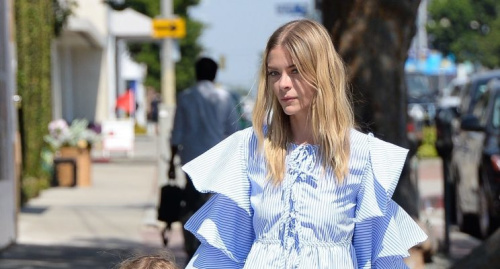 Jaime King wears a ruffled blouse from the fast-fashion site SheIn.