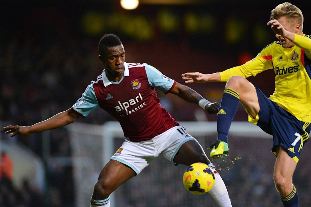 West Ham United's Malian striker Modibo Maiga (left) vies for the ball with Sunderland's Swedish midfielder Sebastian Larsson during their English Premier League match at Upton Park in London on December 14, 2013
