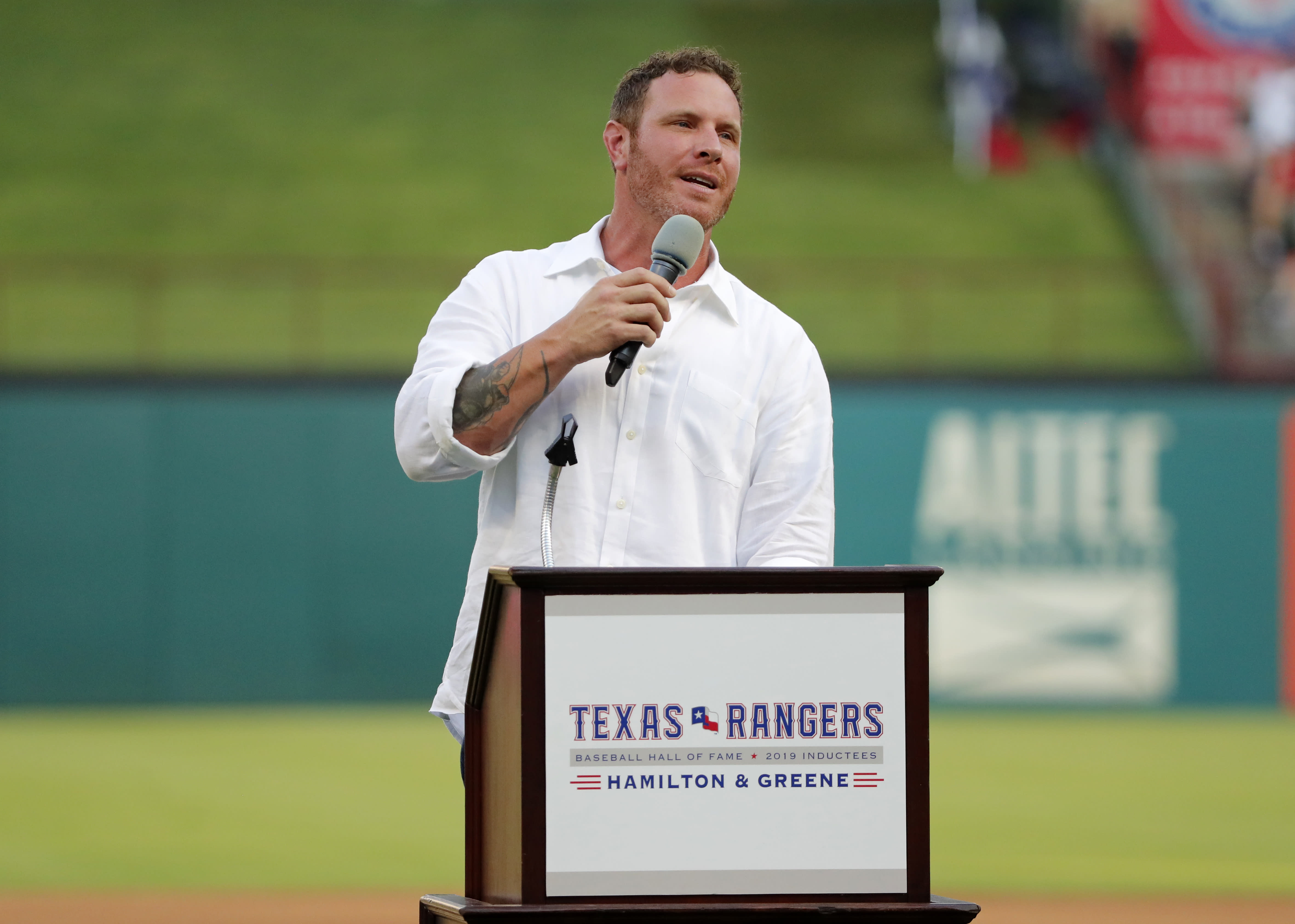 Former Texas Rangers player Josh Hamilton makes comments during a ceremony where the club inducted him into its Hall of Fame, before the team's baseball game against the Minnesota Twins in Arlington, Texas, Saturday, Aug. 17, 2019. (AP Photo/Tony Gutierrez)
