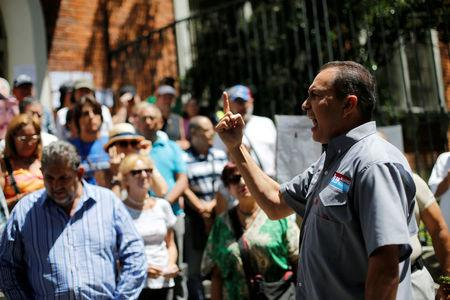 FILE PHOTO: Lawmaker Richard Blanco gives a speech to opposition supporters during a rally against the National Constituent Assembly, outside a school where a polling center will be established for a Constitutional Assembly election next Sunday in Caracas