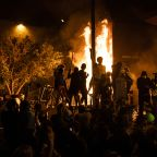 George Floyd protesters set Minneapolis police station afire