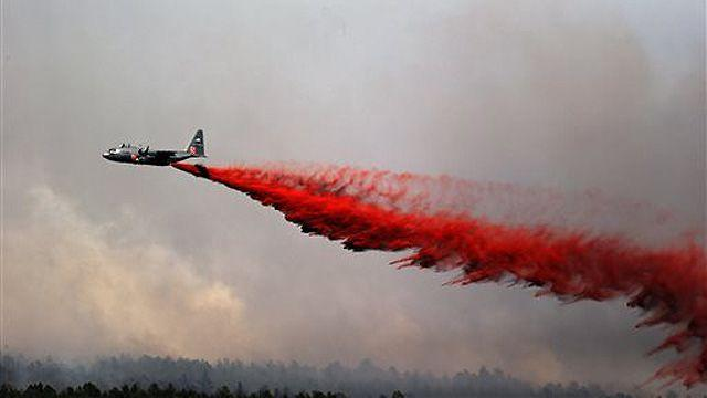 Fast-moving Colo. wildfires consume homes