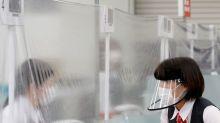 In cash-loving Japan, banks still busy despite coronavirus emergency