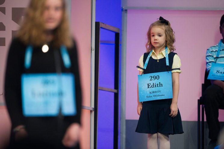 Edith Fuller, 6, from Tulsa, Okla., waits to spell her word in the 90th Scripps National Spelling Bee in Oxon Hill, Md.