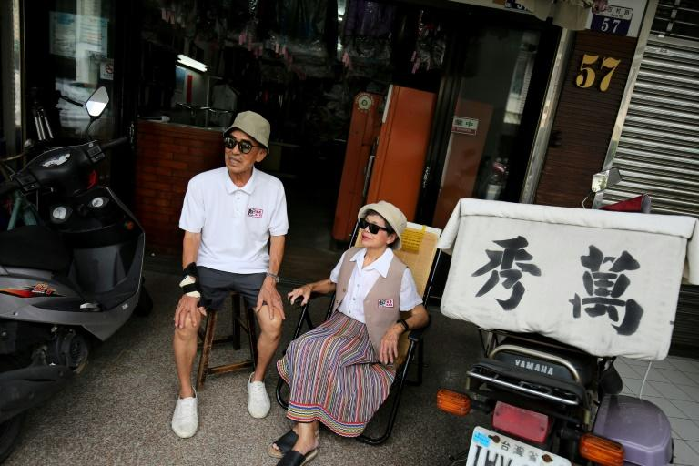 Chang Wan-ji, 83, and his wife Hsu Sho-er, 84, have racked up nearly 600,000 followers on Instagram over the last month as their attitude-filled fashion portraits went viral (AFP Photo/HSU Tsun-hsu)