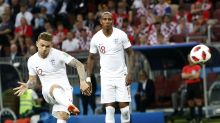 AP PHOTOS: Croatia's resolve overcomes England's youth
