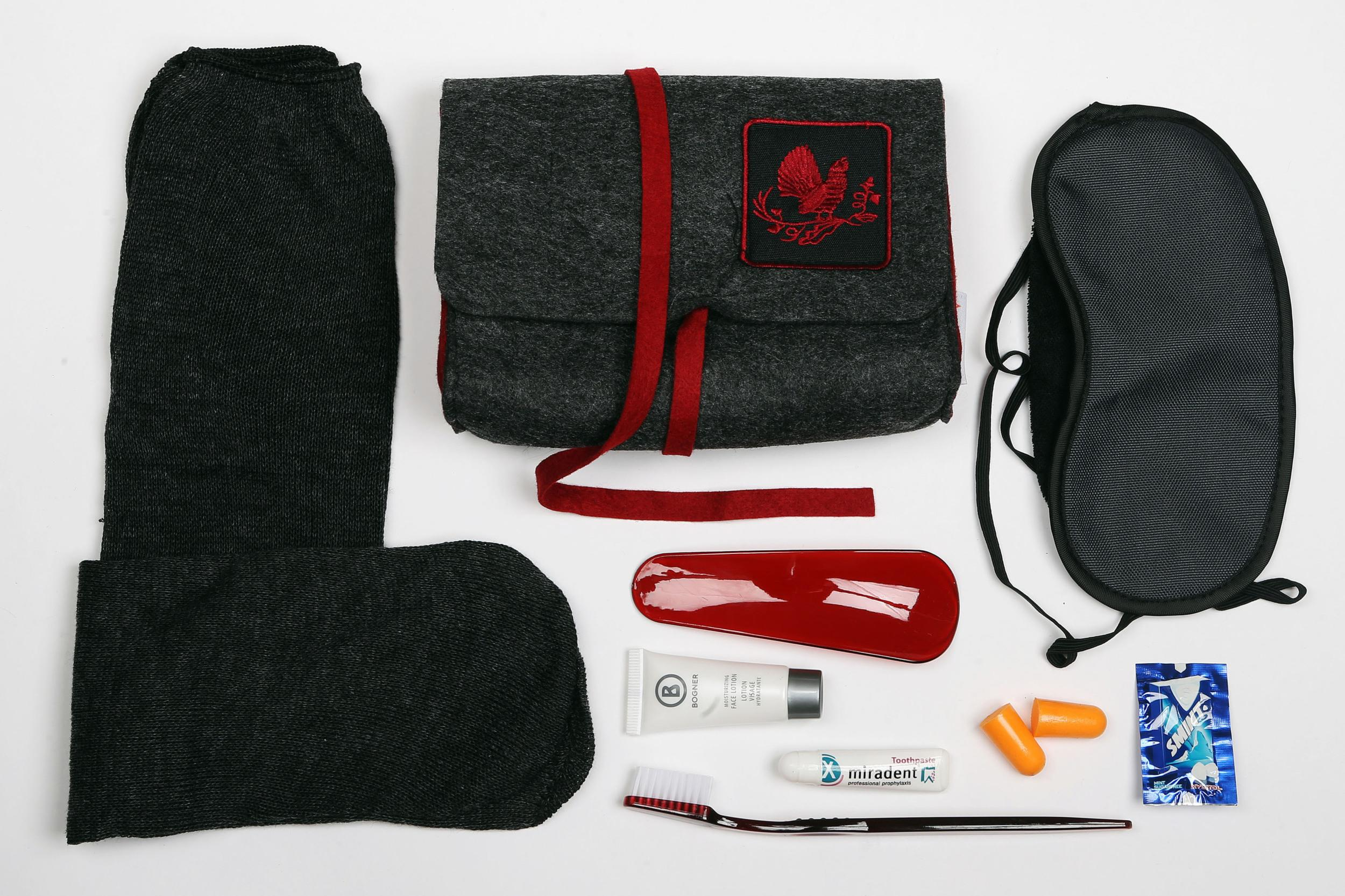 """<p><strong>What do you get?</strong> Pair of socks, eye mask, toothbrush, shoe horn, ear plugs, mini face lotion, mints, a gift voucher of €25 to spend on <a href=""""http://bogner.com"""" target=""""_blank"""">bogner.com</a>.<br /> <strong>Best bit of kit?</strong> The bag. It's soft, elegant and beautifully produced.</p>"""