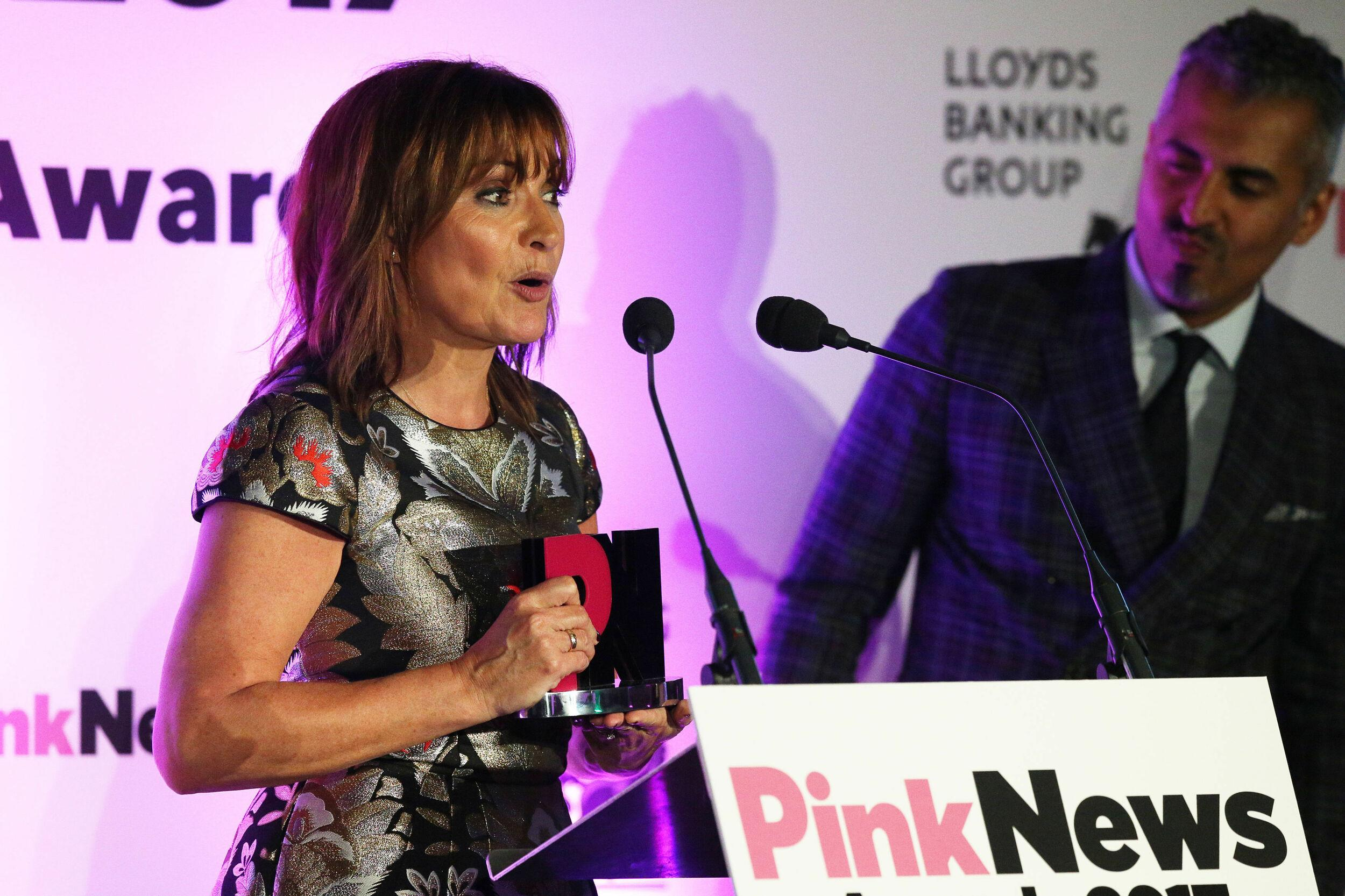 Maajid Nawaz and Lorraine Kelly receive a Pink News Broadcast Award during the the PinkNews awards dinner at One Great George Street in London.