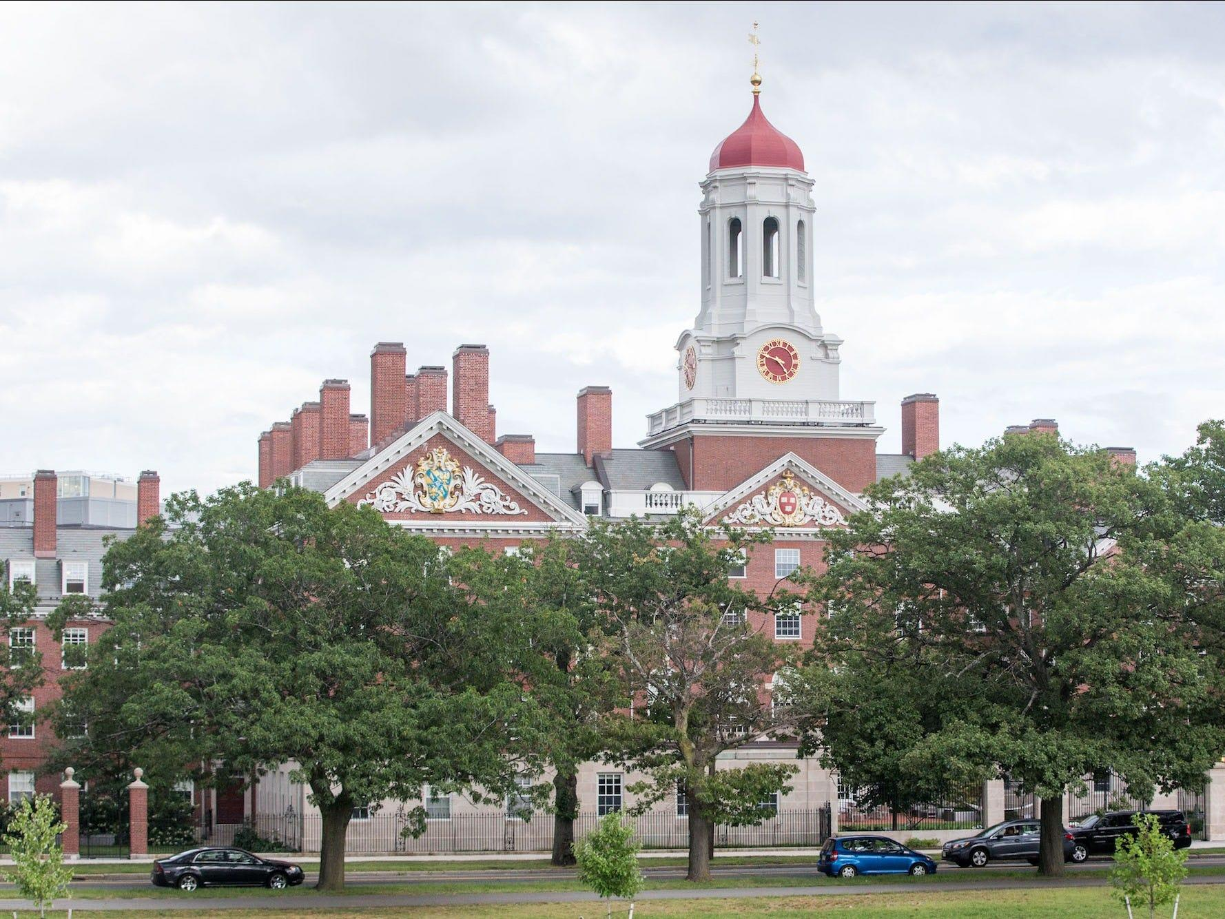 A wealthy businessman was charged with bribery over alleged payments of $1.5 million to get his sons into Harvard