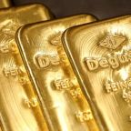 Gold rises on dollar dip, hopes for U.S. relief package