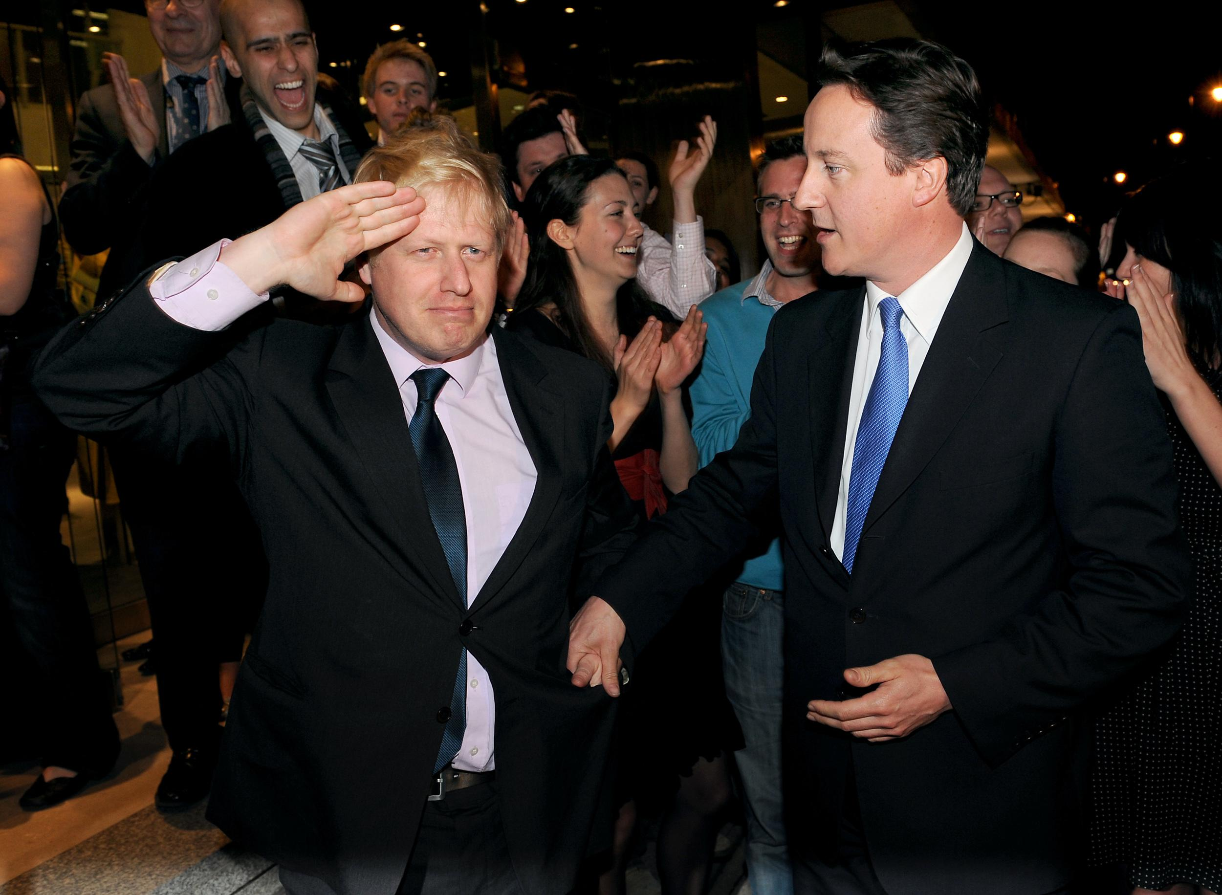 Conservative Party leader David Cameron congratulates Boris Johnson on becoming London Mayor at Tory HQ in central London.