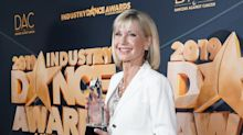Olivia Newton-John makes red carpet return after breaking pelvis due to stage IV cancer