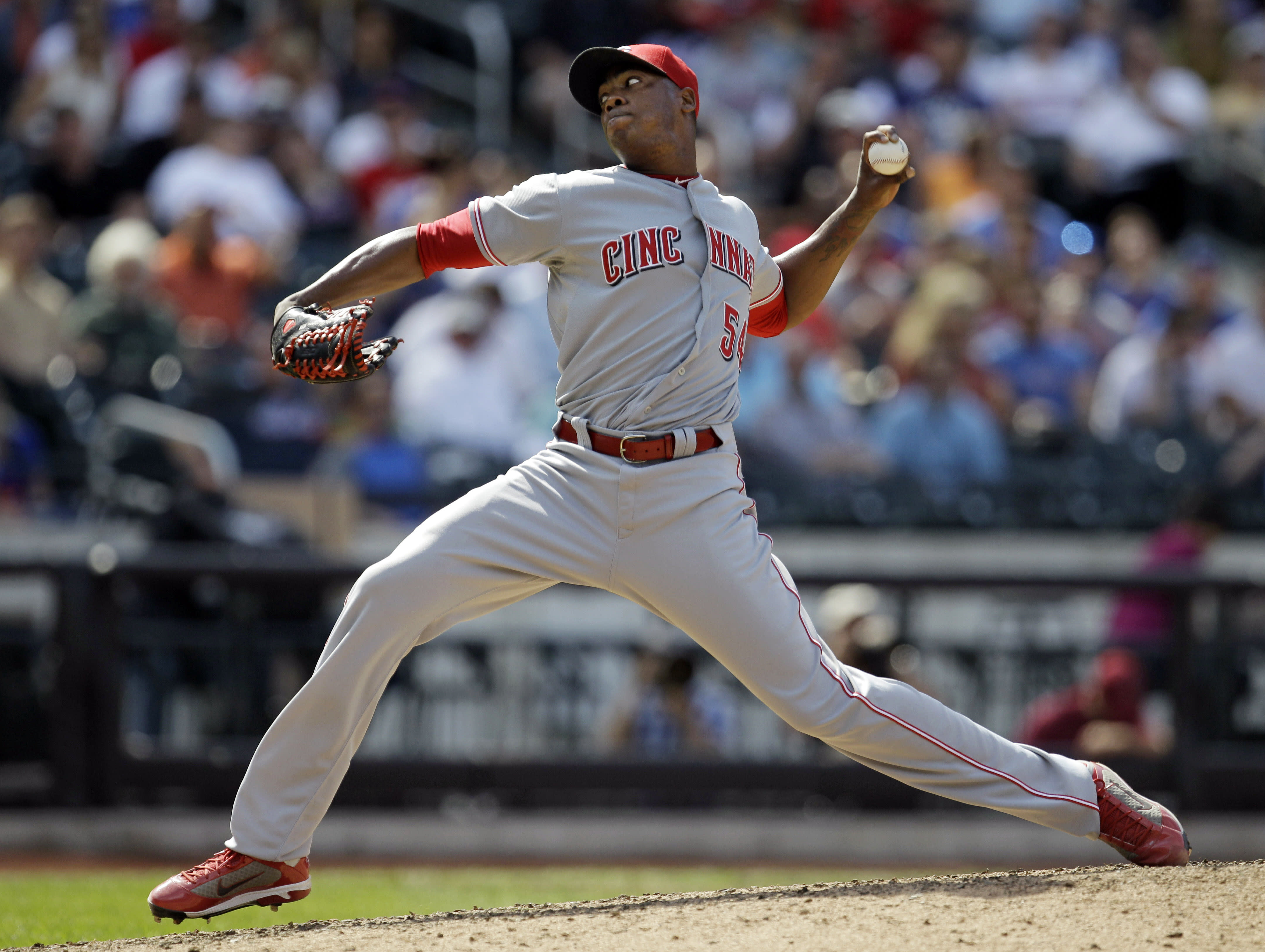 Cincinnati Reds relief pitcher Aroldis Chapman throws in the seventh inning of a baseball game against the New York Mets at Citi Field in New York, Thursday, May 17, 2012. The Mets won 9-4. (AP Photo/Kathy Willens)