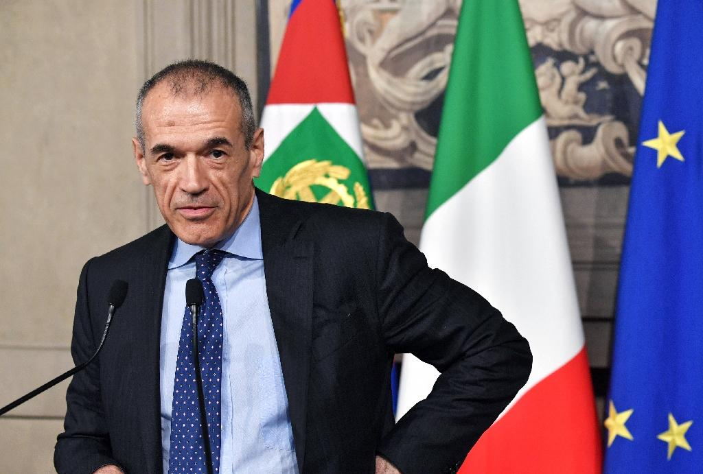 Carlo Cottarelli has a caretaker team ready to step in should fresh negotiations fail between the Five Star Movement and the League (AFP Photo/Andreas SOLARO)