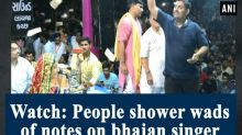 Watch: People shower wads of notes on bhajan singer