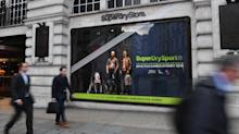 Superdry shares tumble after profit warning