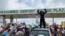 Nigeria's Buhari promises police reform; one protester killed