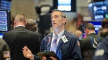Fed rate-cut sign boosts global stocks, dollar drops