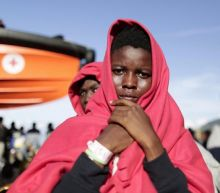 Italian Coast Guard videos show refugees pulled to safety in Mediterranean Sea