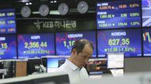 Asian stocks tumble after new Trump tariff threat