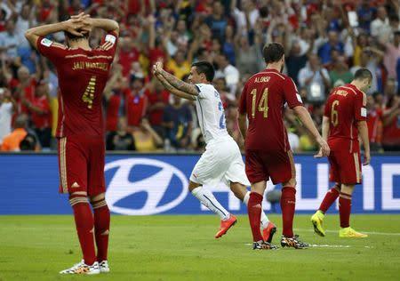 Chile's Charles Aranguiz celebrates scoring a goal during their 2014 World Cup Group B soccer match against Spain at the Maracana stadium in Rio de Janeiro
