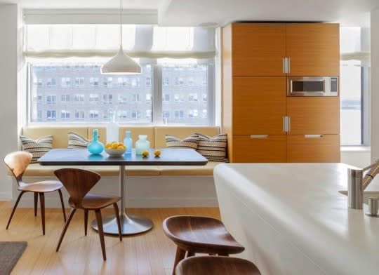 """<p>A clever space saver from years gone by, a nook equipped with banquettes still provides an efficient solution for <a href=""""http://www.bobvila.com/slideshow/11-inspiring-kitchens-that-defy-their-small-size-47280?bv=yahoo"""" rel=""""nofollow noopener"""" target=""""_blank"""" data-ylk=""""slk:smaller kitchens"""" class=""""link rapid-noclick-resp"""">smaller kitchens</a> and a cozy spot for family meals. If your design allows it, equip the benches with hinges to provide hidden storage for board games, table linens, or even homework supplies.</p><p><b>Related: <a href=""""http://www.bobvila.com/slideshow/trending-now-banquette-seating-44342?bv=yahoo"""" rel=""""nofollow noopener"""" target=""""_blank"""" data-ylk=""""slk:Trending Now—Banquette Seating"""" class=""""link rapid-noclick-resp"""">Trending Now—Banquette Seating</a> </b> </p><p><i>Source: Bob Vila</i></p>"""