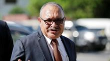 Papua New Guinea police seeking to arrest ex-PM O'Neill