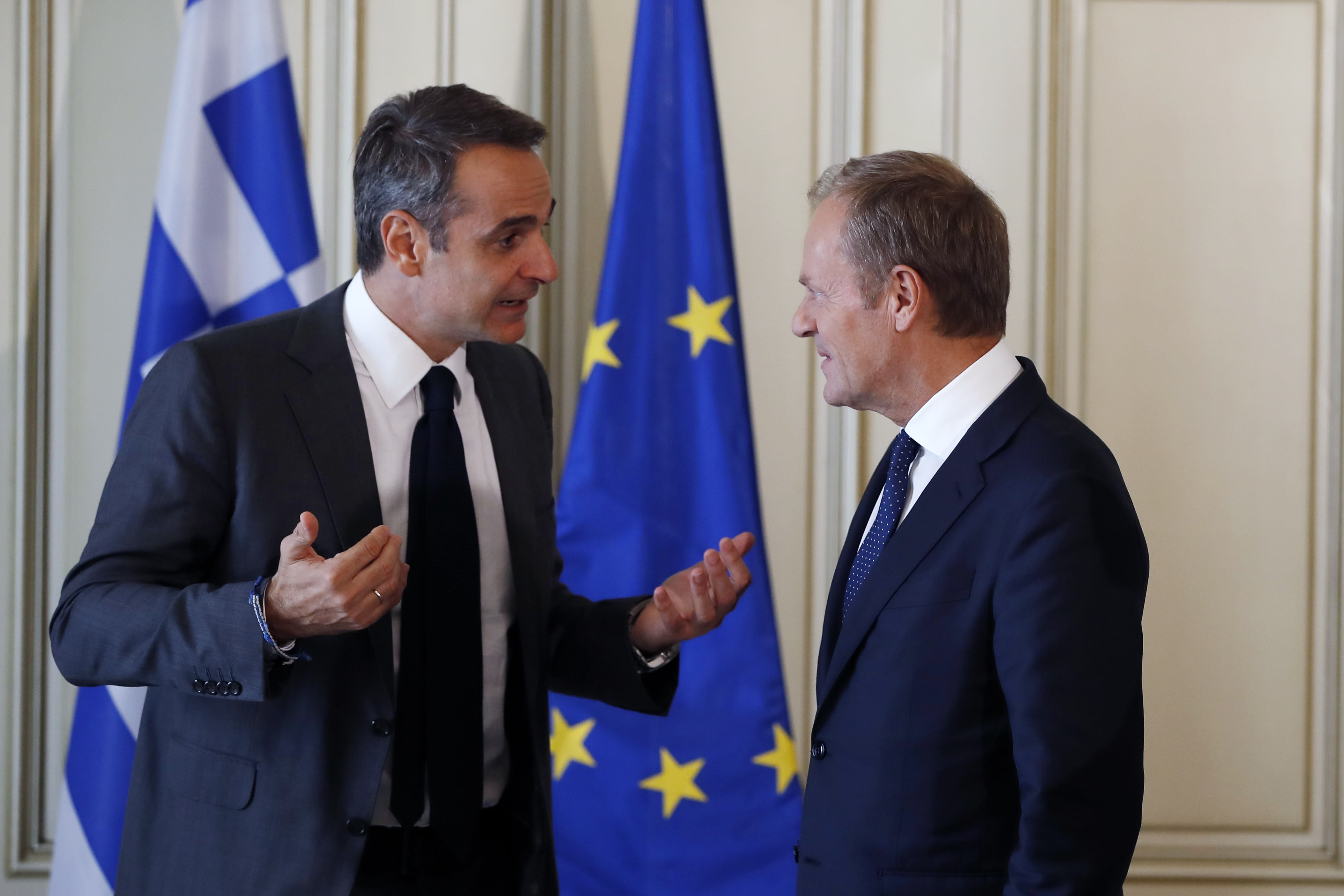 """Greece's Prime Minister Kyriakos Mitsotakis, left, speaks with the European Council President Donald Tusk during their meeting at Maximos Mansion in Athens, Wednesday, Oct. 9, 2019. EU leaders have demanded more """"realism"""" from Britain in response to a Brexit plan proposed by British Prime Minister Boris Johnson. (AP Photo/Thanassis Stavrakis)"""