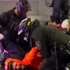 Seattle police officer caught kneeling on the necks of multiple George Floyd protestors
