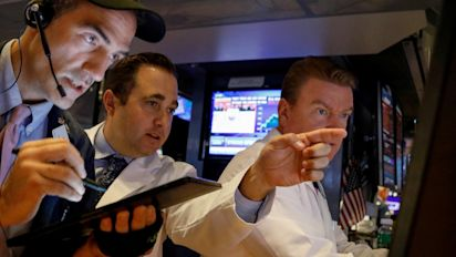Stocks fall and then rebound after Fed decision