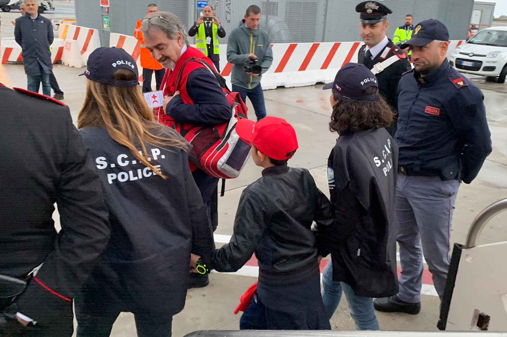 In this photo released by the Italian Police, 11-year-old Alvin, an Albanian boy who was taken to Syria by his mother when she joined the Islamic State group and then, following her death, has been freed from a crowded detention camp in northeastern Syria and returned home to Italy where his father lives, arrives at Rome's Fiumicino airport Friday, Nov. 8, 2019. (Italian Police via AP)