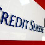 Under watchdog scrutiny, Credit Suisse caps assets and leverage