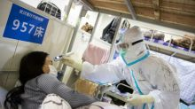 WHO urges calm as China virus death toll nears 1,900