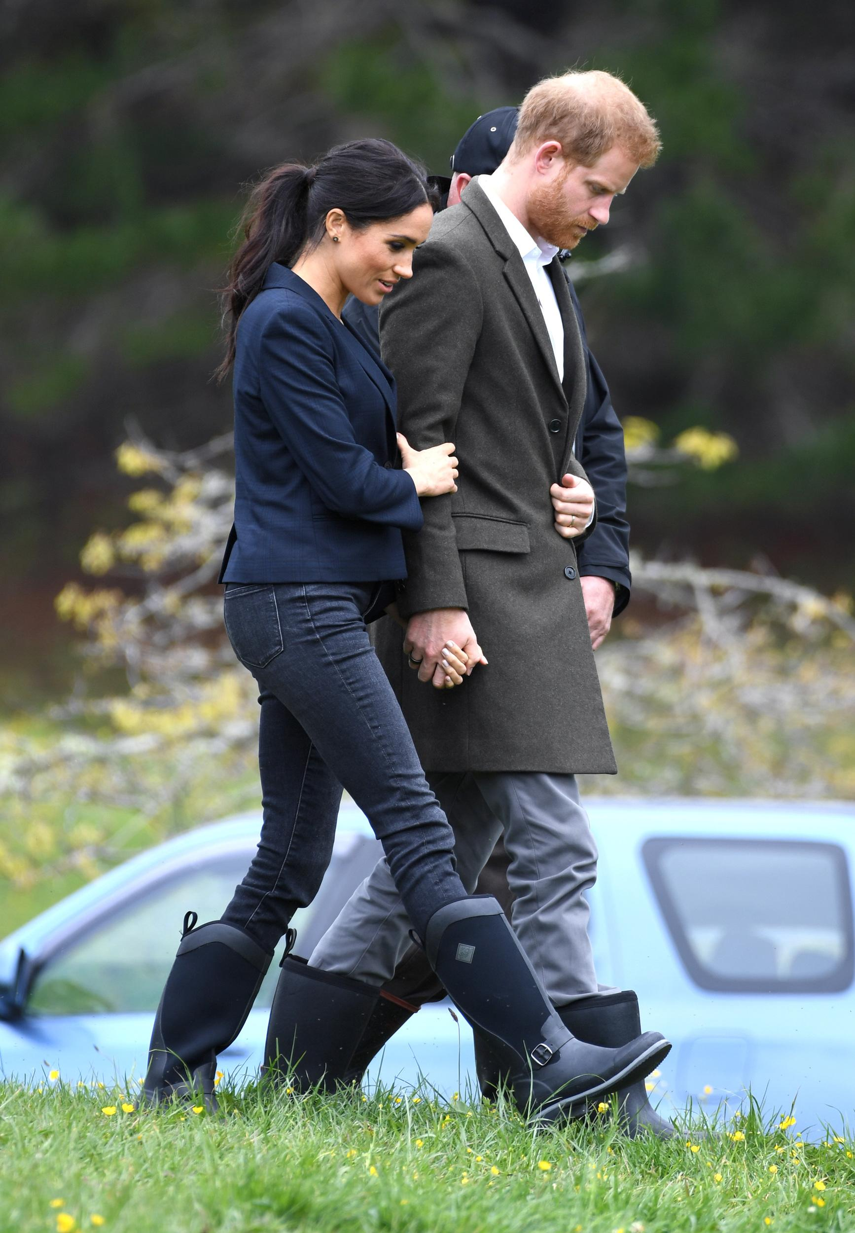 Prince Harry Duke of Sussex and Meghan Duchess of Sussex take part in the dedication of the Carol Whaley Native Bush to the Queen's Commonwealth Canopy. They also planted two trees and took part in a Welly Wanging contest which Team Duchess of Sussex won at Redvale, North Shore,New Zealand. Photo credit should read: Doug Peters/EMPICS