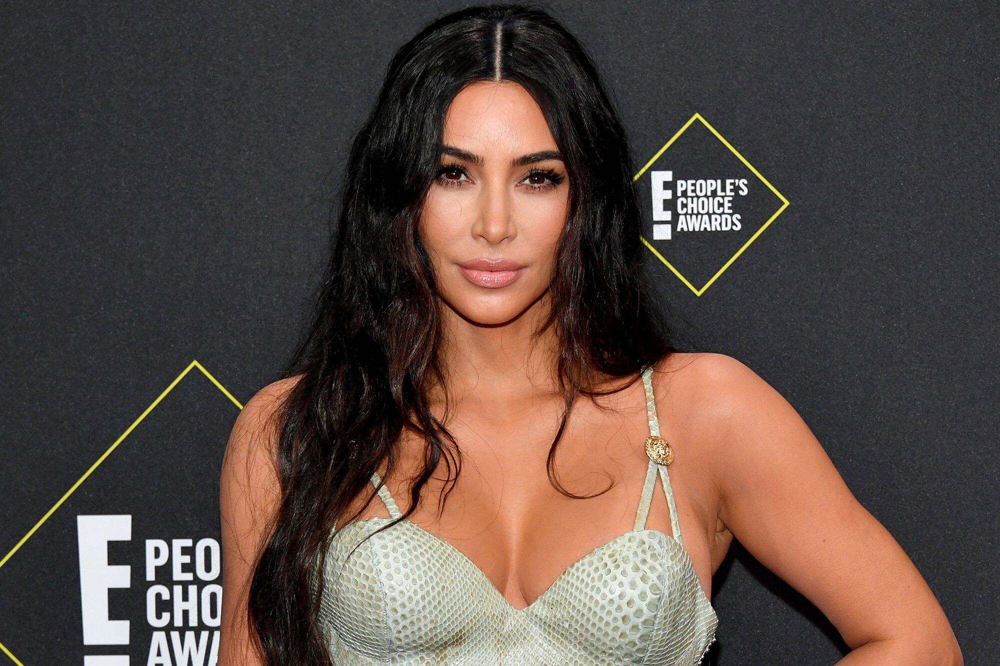 Kim Kardashian Teases Blonde Locks and Bleached Eyebrows Before Going 'Back to Dark'