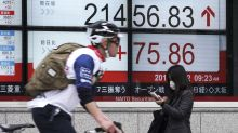 Asian shares mixed after Fed raises interest rates