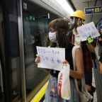 Hong Kong protesters gather at mob-attack subway as bank warns of economic fallout