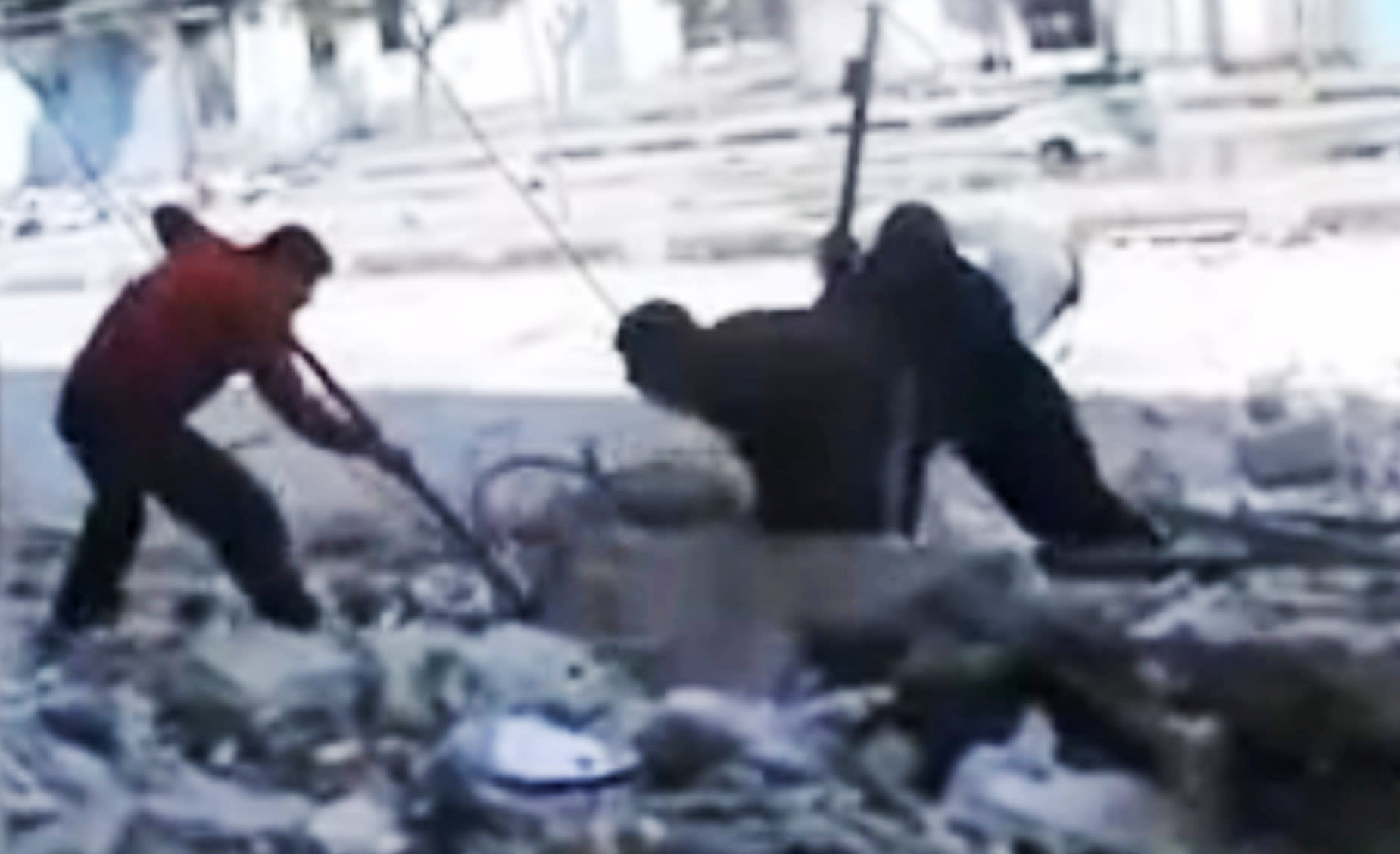 This image made from amateur video and released by the Syria media center Friday, March 23, 2012, purports to show Syrians pulling out the body of a man under the rubble of a building that was bombed in Homs, Syria. Syrian President Bashar Assad says he will spare no effort to make the mission of U.N.-Arab League envoy Kofi Annan a success but he demands that armed opponents commit to halting violence. (AP Photo/Syria Media Center via APTN) THE ASSOCIATED PRESS CANNOT INDEPENDENTLY VERIFY THE CONTENT, DATE, LOCATION OR AUTHENTICITY OF THIS MATERIAL. TV OUT