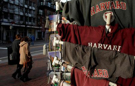 FILE PHOTO: People walk past Harvard University t-shirts for sale in Harvard Square in Cambridge