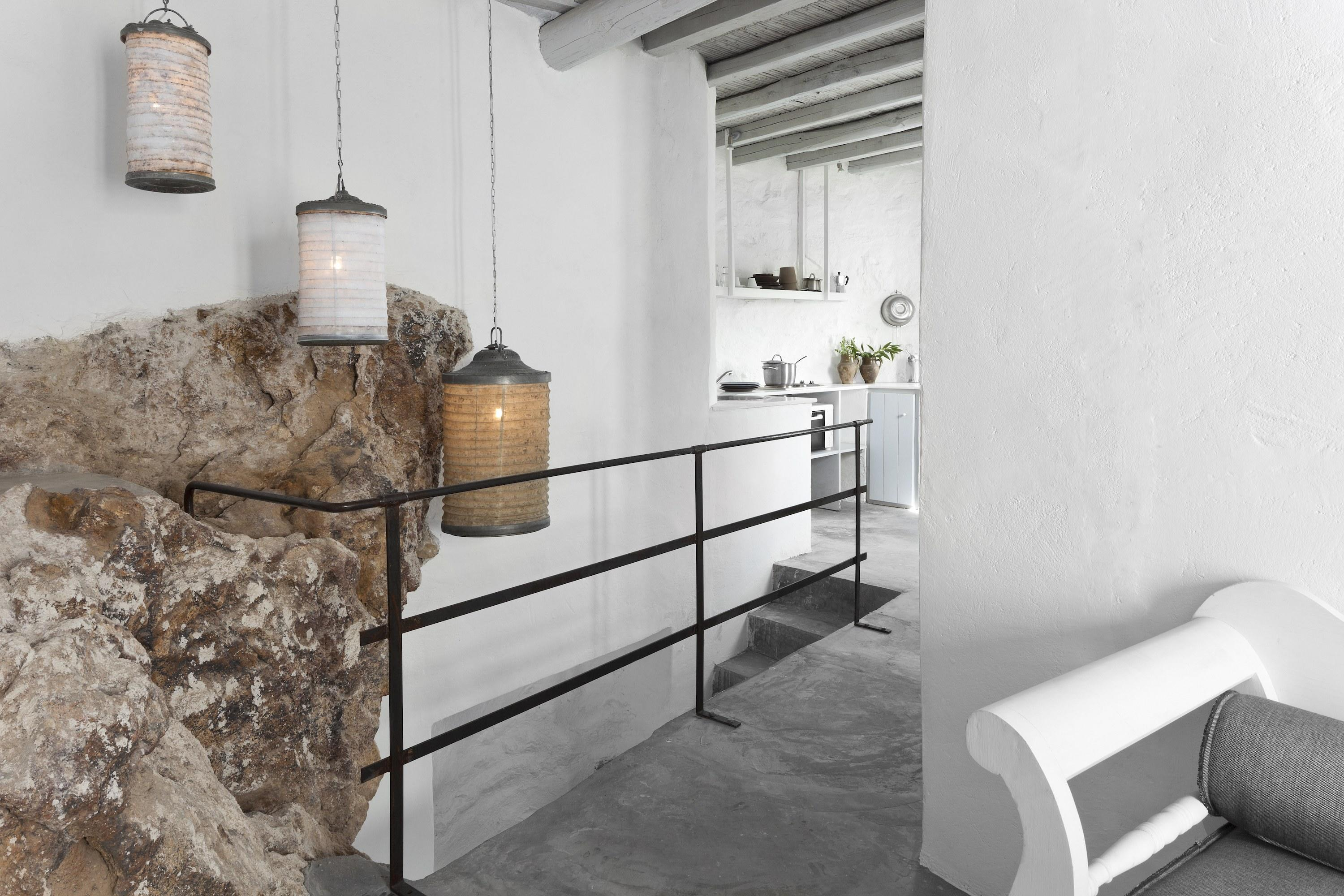 """At this <a href=""""https://www.designhotels.com/hotels/greece/serifos/coco-mat"""" rel=""""nofollow noopener"""" target=""""_blank"""" data-ylk=""""slk:Design Hotels property"""" class=""""link rapid-noclick-resp"""">Design Hotels property</a>, Greek architect George Zafiriou revamped former miners' quarters into two-story apartments with sea views. Responsible for the interiors, designers Ioanna Founti and Zili Karahaliou drafted open spaces in earth tones and filled the rooms with furniture made of natural fibers like coconut and chestnut. The beds are Coco-Mat—which is unsurprising, given that the hotel is an extension of the brand, which was founded in 1989 in Greece and makes all of its mattresses in the country from materials including seaweed and cactus fibers."""