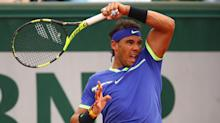 Rafael Nadal breezes past Benoit Paire to reach French Open second round