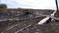 At site of MH17 crash, fighting stalls recovery effort