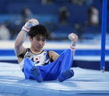 Japan surges to gymnastics lead; Reigning champ Uchimura out