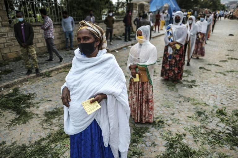 Voters line up to vote in a regional election in Tigray that was banned by the federal government due to the coronavirus pandemic