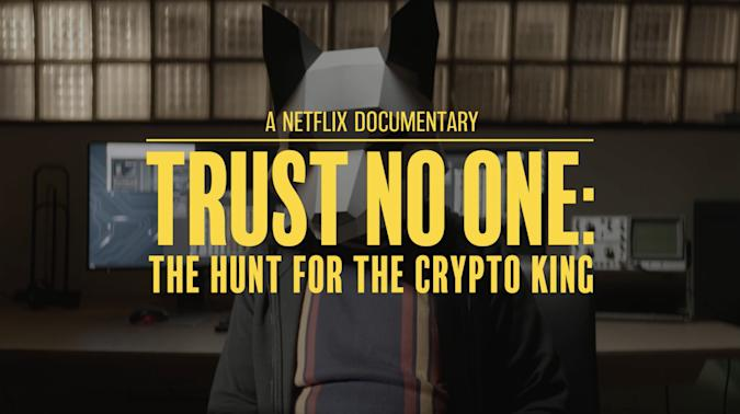 """Text reading """"A Netflix Documentary. Trust No One: The Hunt For The Crypto King"""" laid over an image of a person wearing shat appears to be a bear mask."""