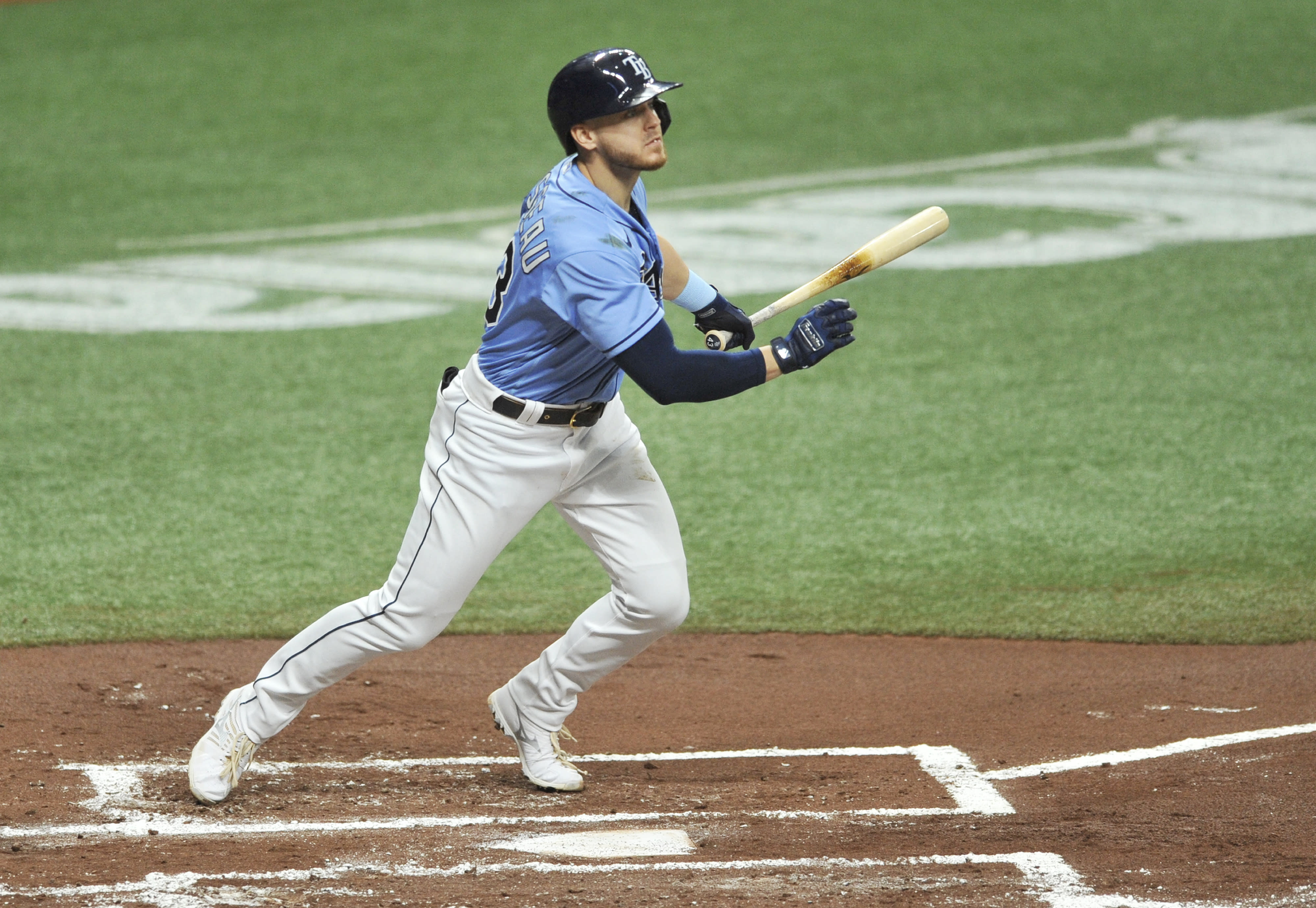 Tampa Bay Rays' Michael Brosseau hits an RBI-double off Boston Red Sox starter Martin Perez during the first inning of a baseball game Sunday, Sept. 13, 2020, in St. Petersburg, Fla. (AP Photo/Steve Nesius)